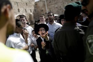 Jewish Ultra Orthodox men demonstrate as women pray at Western Wall