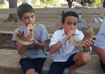 Boys blowing shofar