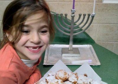 Girl Lighting Chanukah Masorti Israel