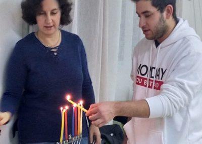 Couple lighting Chanuka Candles